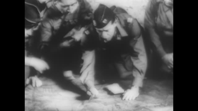allied soldiers kneel in group planning dday during wwii - d day stock videos & royalty-free footage