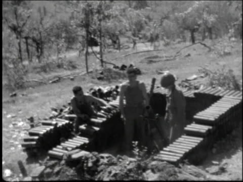 allied soldiers load and fire rocket launcher surrounded my a bunker of weapons - 1944 stock videos and b-roll footage