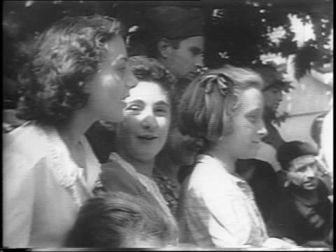 allied soldiers marching captured nazi soldiers through streets / french civilians behind gate waving emphatically / closeup on french man cheering... - hands behind head stock videos and b-roll footage