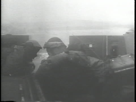 vidéos et rushes de allied soldiers on landing craft tanks approach the beaches of normandy for the d-day invasion during world war ii. - sport