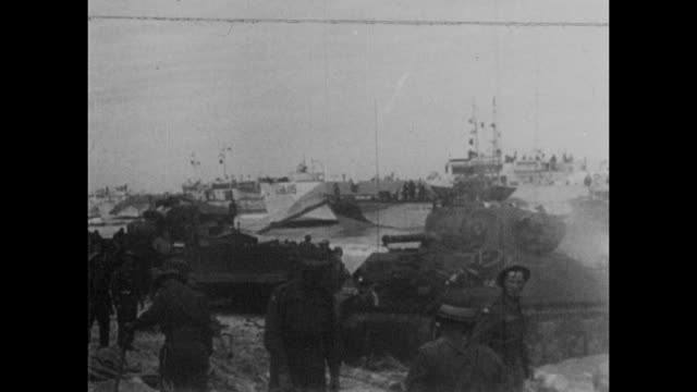 allied troops and tanks moving into france after the success of the dday landings german pows and liberated french citizens in normandy in june 1944 - arromanches stock videos & royalty-free footage