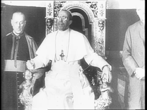 allied troops gather in saint peter's cathedral to hear the pope pius xii give his blessing to the allies / pope is carried in and gives blessings as... - pope stock videos & royalty-free footage