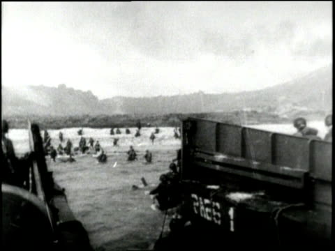 allied troops invade normandy france on dday - dデイ点の映像素材/bロール