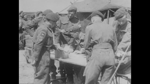 allied troops receive a briefing and prepare their equipment before launching d-day landings during world war ii in june 1944. - d day stock videos & royalty-free footage