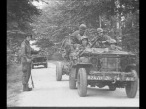 allied troops sit on ground with map as local dutch women give them directions during world war ii / allied soldiers approach, riding in jeeps /... - militärisches landfahrzeug stock-videos und b-roll-filmmaterial