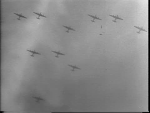 allied war planes, bombers over italy / b-24 liberator bomber in air / aerial view of ship on the water / b-25 mitchell dropping and exploding on... - bombardamento video stock e b–roll