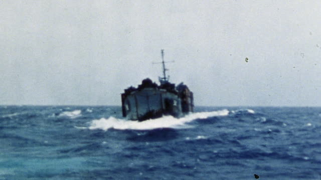 allied warship rolling from side to side while navigating rough waters on journey from ulithi to okinawa during wwii pacific campaign - dondolarsi video stock e b–roll