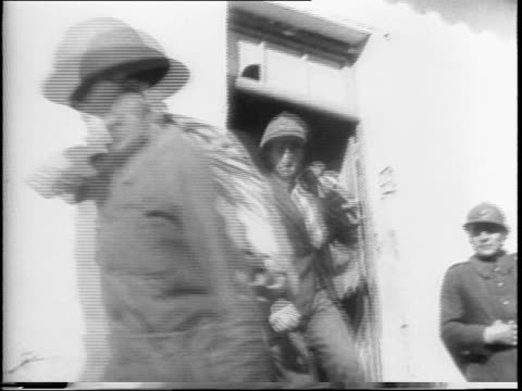 allies free french vichy prisoners to become soldiers / a line of free men shake hands with a french military officer and enter barracks / come back... - prisoner video stock e b–roll