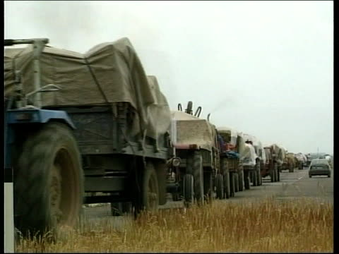 Allies send in land forces ITN MSs Group of Serb civilians on road who claim their houses have been taken over by the KLA Ljiljiana Bojkovic...