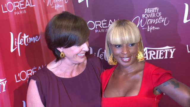 Allison Janney and Mary J Blige at the Variety's 3rd Annual 'Power of Women' Luncheon at Beverly Hills CA