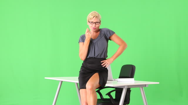 alluring and provocative businesswoman being sexy by desk - sekretärin stock-videos und b-roll-filmmaterial
