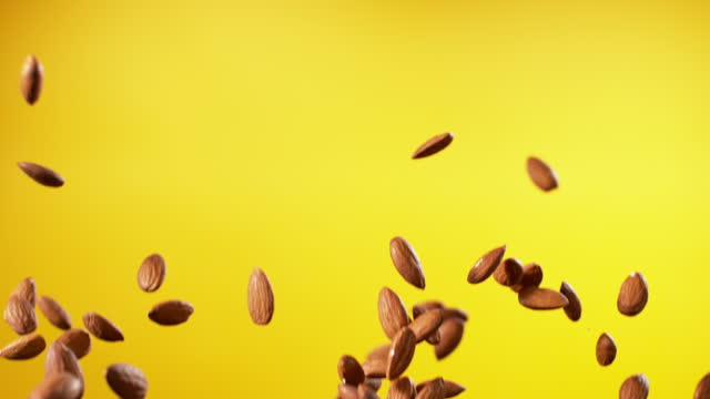 almond rising up and falling - small stock videos & royalty-free footage