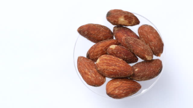 almond rotate on white background - raw food stock videos & royalty-free footage