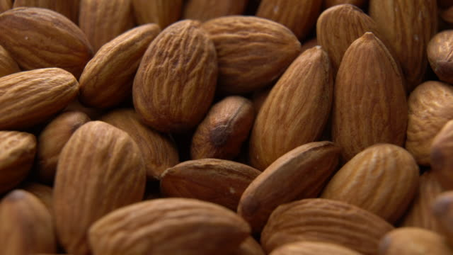 almonds heap rotating with close up shot - almond stock videos & royalty-free footage