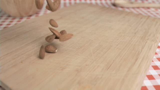 almonds in super slow motion - mandel stock-videos und b-roll-filmmaterial