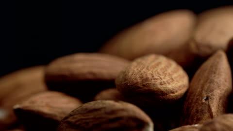 ecu almonds rotating - still life stock videos & royalty-free footage