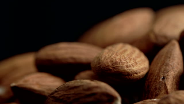 ecu almonds rotating - still life stock videos & royalty-free footage