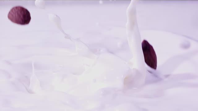 almonds splashing into milk super slow motion 1000 fps - almond stock videos & royalty-free footage