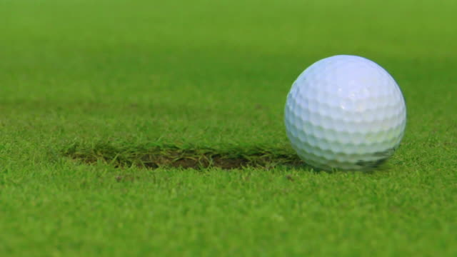 almost.. close but no cigar - golf ball stock videos & royalty-free footage