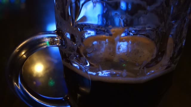 Almost empty glass of beer