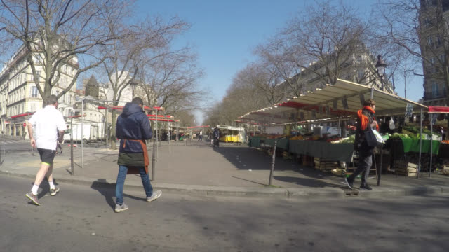 almost few people and far fewer merchants at the food market boulevard richardlenoir paris third day of confinement in francemarch 1ç 2020 in paris... - french food market stock videos & royalty-free footage