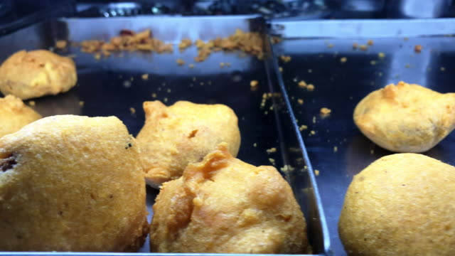 almost finished! - mumbai's famous savory deep fried potato filled snacks - savory food stock videos & royalty-free footage