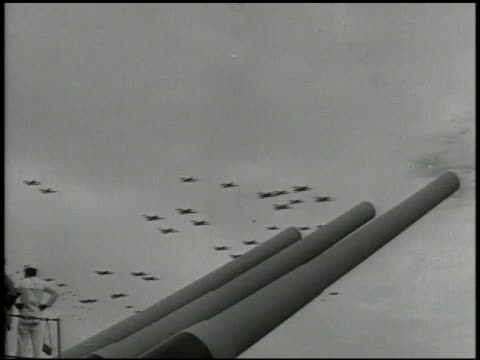 almost silhouette of formations of united states fighter jets flying overhead, u.s. navy battleship cannons aimed up fg during ceremony. wwii, tokyo... - pacific war video stock e b–roll