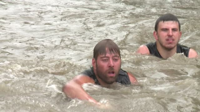 almost sixthousand runners took on the tough mudder challenge a 15 kilometre obstacle course through thick mud in northern england on sunday - tough mudder stock videos and b-roll footage
