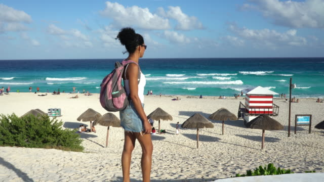 alone female traveller arriving beach motion cam - cancun stock videos & royalty-free footage