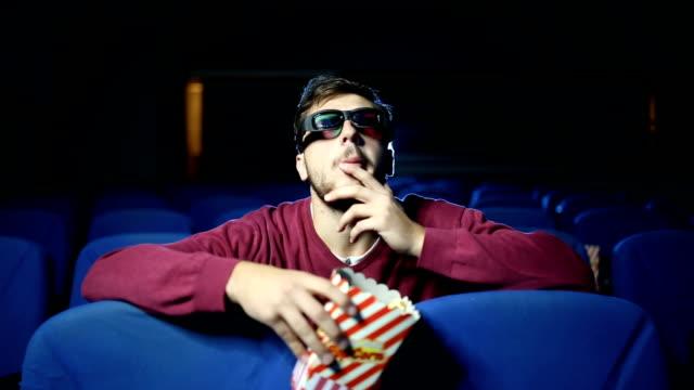 Alone in cinema eating popcorn