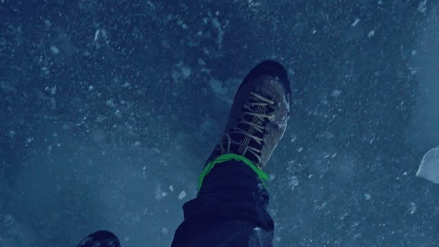 alone in the mountains. walking with crampons. iceberg - hiking pole stock videos and b-roll footage