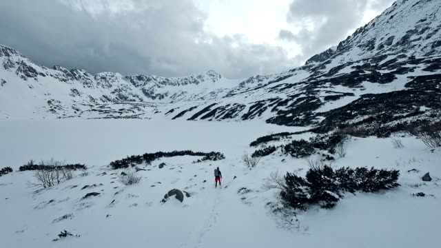 alone in the mountains. winter trip. aerial view - blizzard stock videos & royalty-free footage