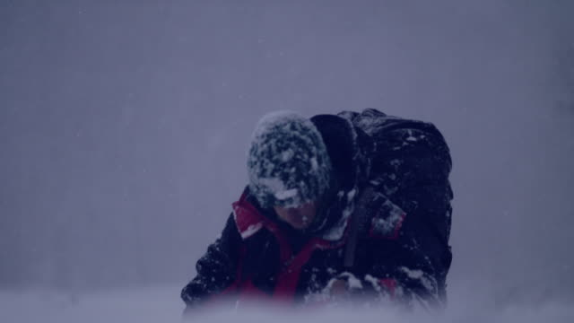alone in the mountains. winter trip. falling down on snow - blizzard stock videos & royalty-free footage