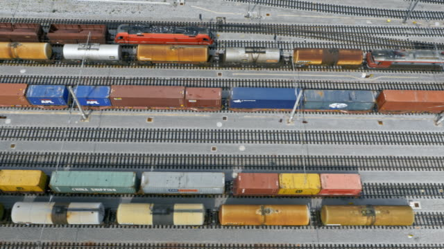 aerial along a cargo train terminal - cargo train stock videos & royalty-free footage
