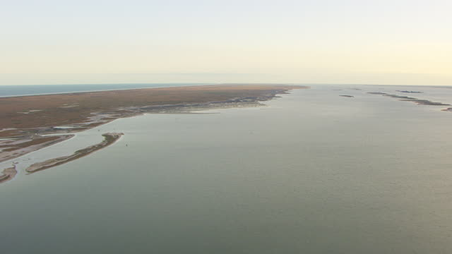 ws aerial ha along beach at padre island at gulf coast / texas, united states - padre stock videos & royalty-free footage