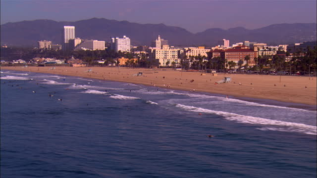 AERIAL along beach, past Santa Monica Pier/ Santa Monica, California