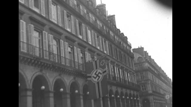 vidéos et rushes de along champs-elysees, german army soldiers on streets, nazi swastikas on banners, street signs / vs german soldiers at racetrack, in stands, arriving... - seconde guerre mondiale