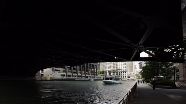 hyperlapse along chicago river fast - michigan avenue bridge stock videos and b-roll footage