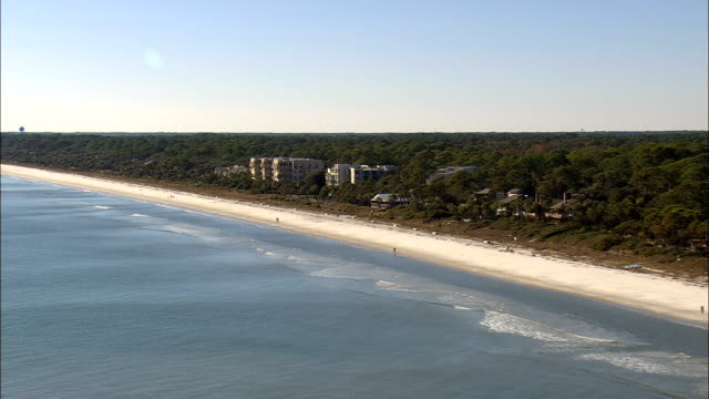 along forest beach  - aerial view - south carolina,  beaufort county,  united states - carolina beach stock videos & royalty-free footage
