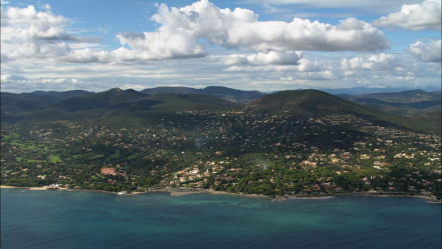 AERIAL along green, hilly coastline/ Saint-Maxime, France