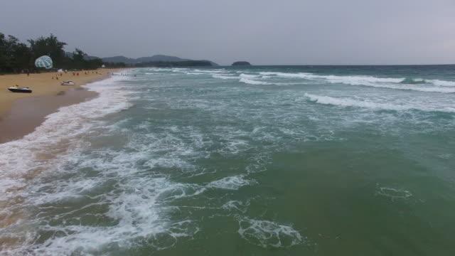 aerial along kata beach in phuket/thailand - プーケット県点の映像素材/bロール