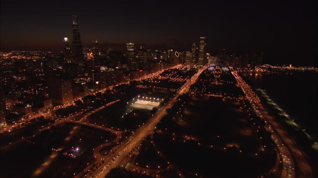 AERIAL, Along Michigan Avenue to Millennium Park at night, Chicago, Illinois, USA