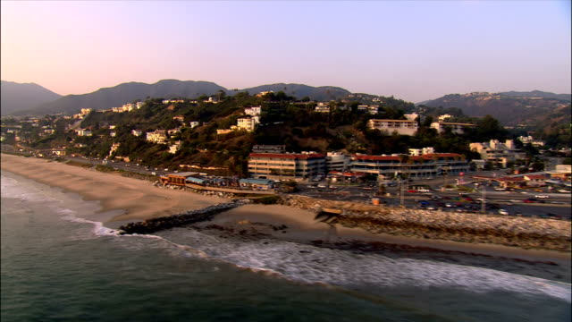 AERIAL Along Pacific Coast Highway on Santa Monica coast / California