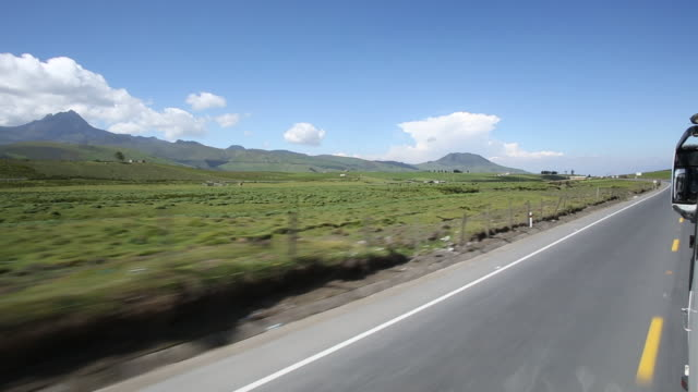 pov along paved road during overland bus ride - passenger point of view stock videos & royalty-free footage