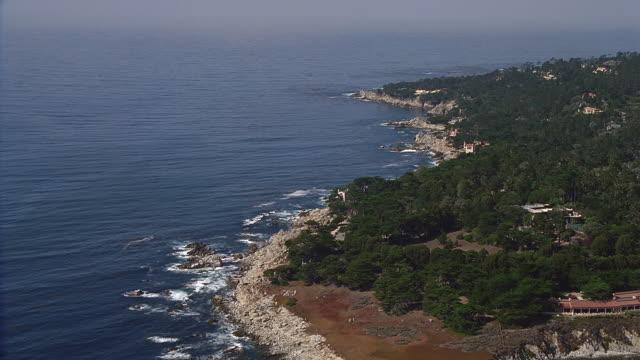 aerial along rocky coastline / carmel, california - rocky coastline stock videos & royalty-free footage
