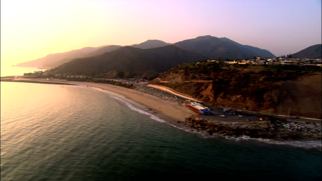 AERIAL Along Santa Monica coastline / California