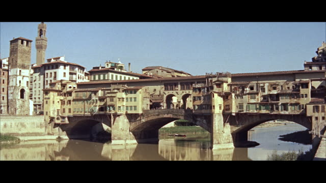 ms along street up through canyon of buildings - florenz italien stock-videos und b-roll-filmmaterial