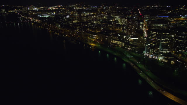 Along the Charles River in Boston at night, passing MIT. Shot in November 2011.