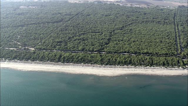 along the coast past ginosa marina  - aerial view - apulia, provincia di taranto, massafra, italy - taranto province stock videos & royalty-free footage