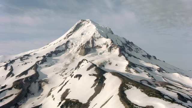 aerial alongside mt. hood slope - snowcapped mountain stock videos & royalty-free footage